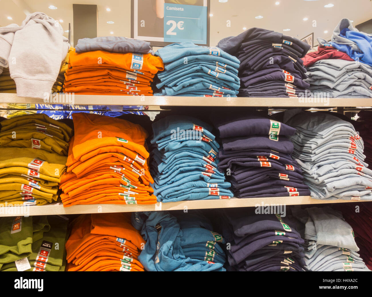 Two Euro T shirts in Primark store in Spain - Stock Image