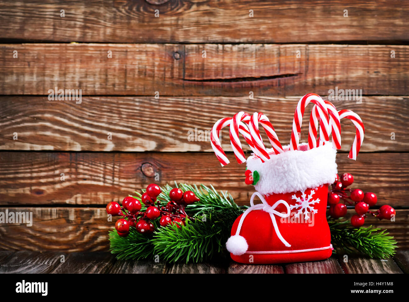 Candy Canes And Christmas Decoration On A Table Stock Photo