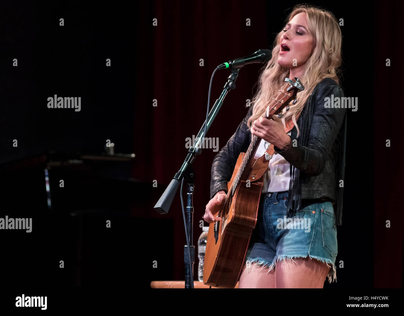 Singer Jewel performs to a standing-room only crowd at the 2015 Americana Fest on Sept. 15th, 2015, in Nashville, - Stock Image