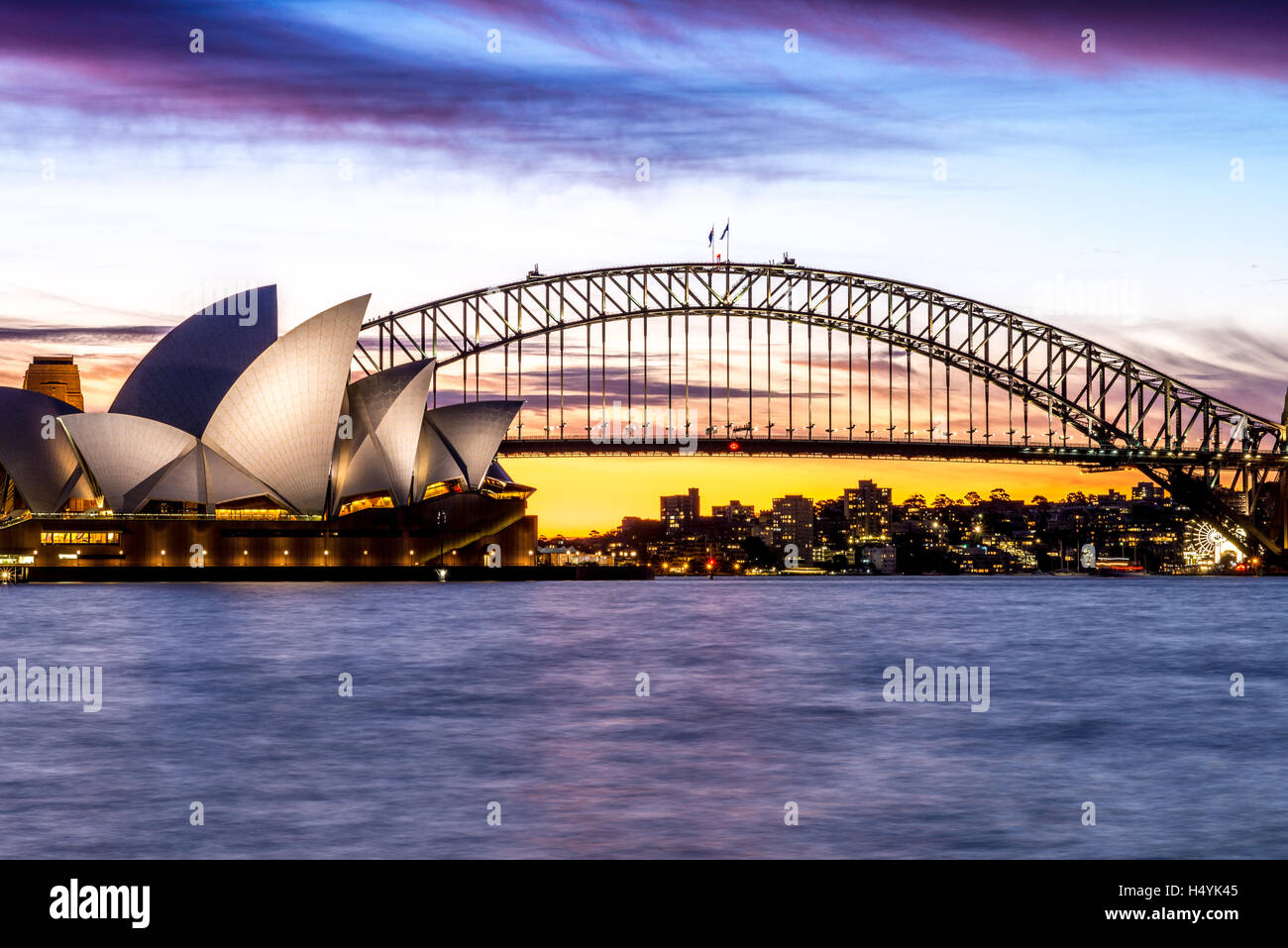 Sydney Opera House and the Sydney Harbour Bridge during a glorious sunset Stock Photo