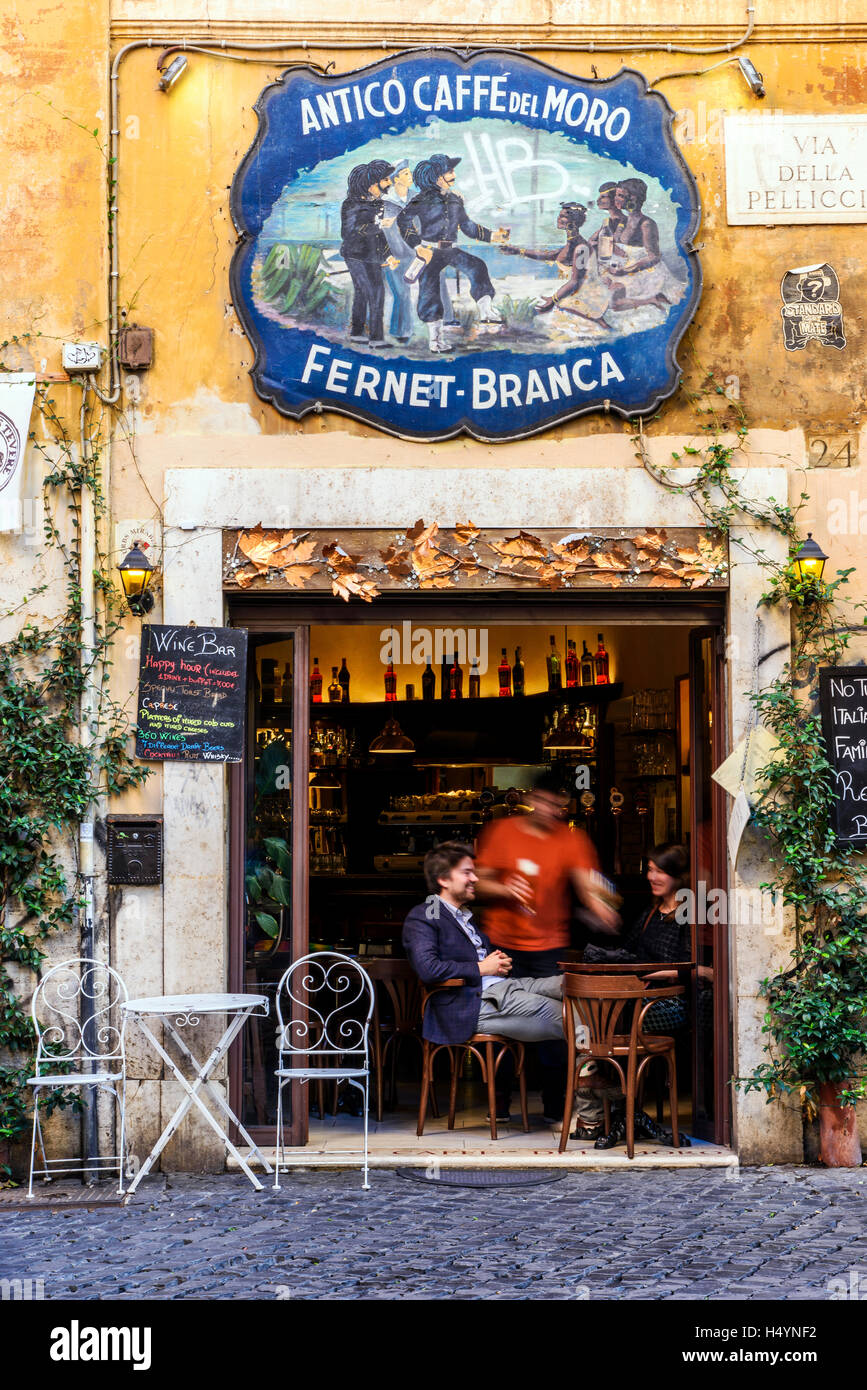 Tourists seated at bar in Trastevere district, Rome, Lazio, Italy - Stock Image