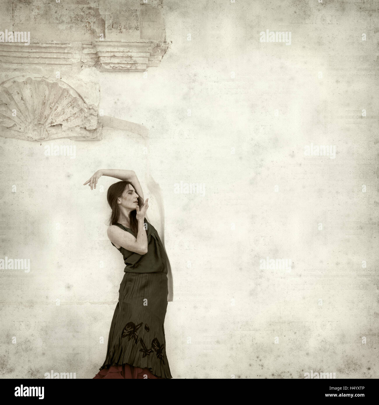 textured old paper background with flamenco dancer in ruins of old church - Stock Image