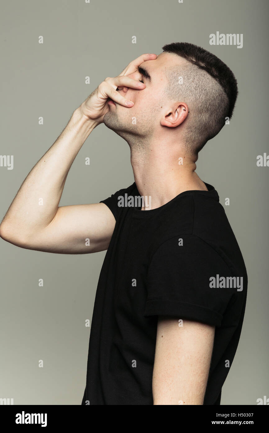 Side-view of man, who feeling shame - Stock Image