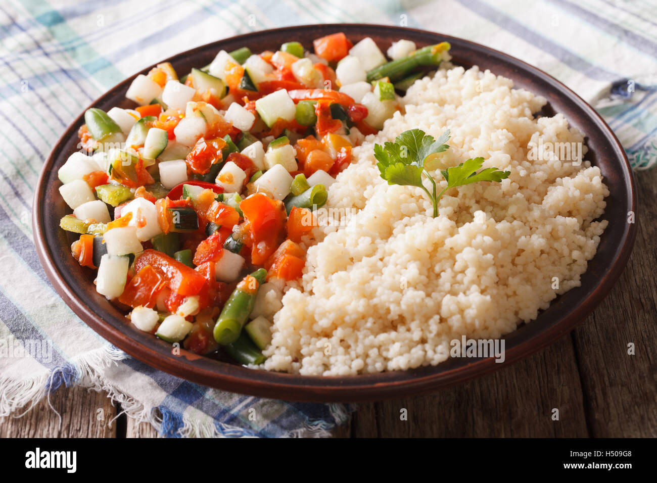 Couscous with vegetables and herbs closeup on the table. horizontal Stock Photo