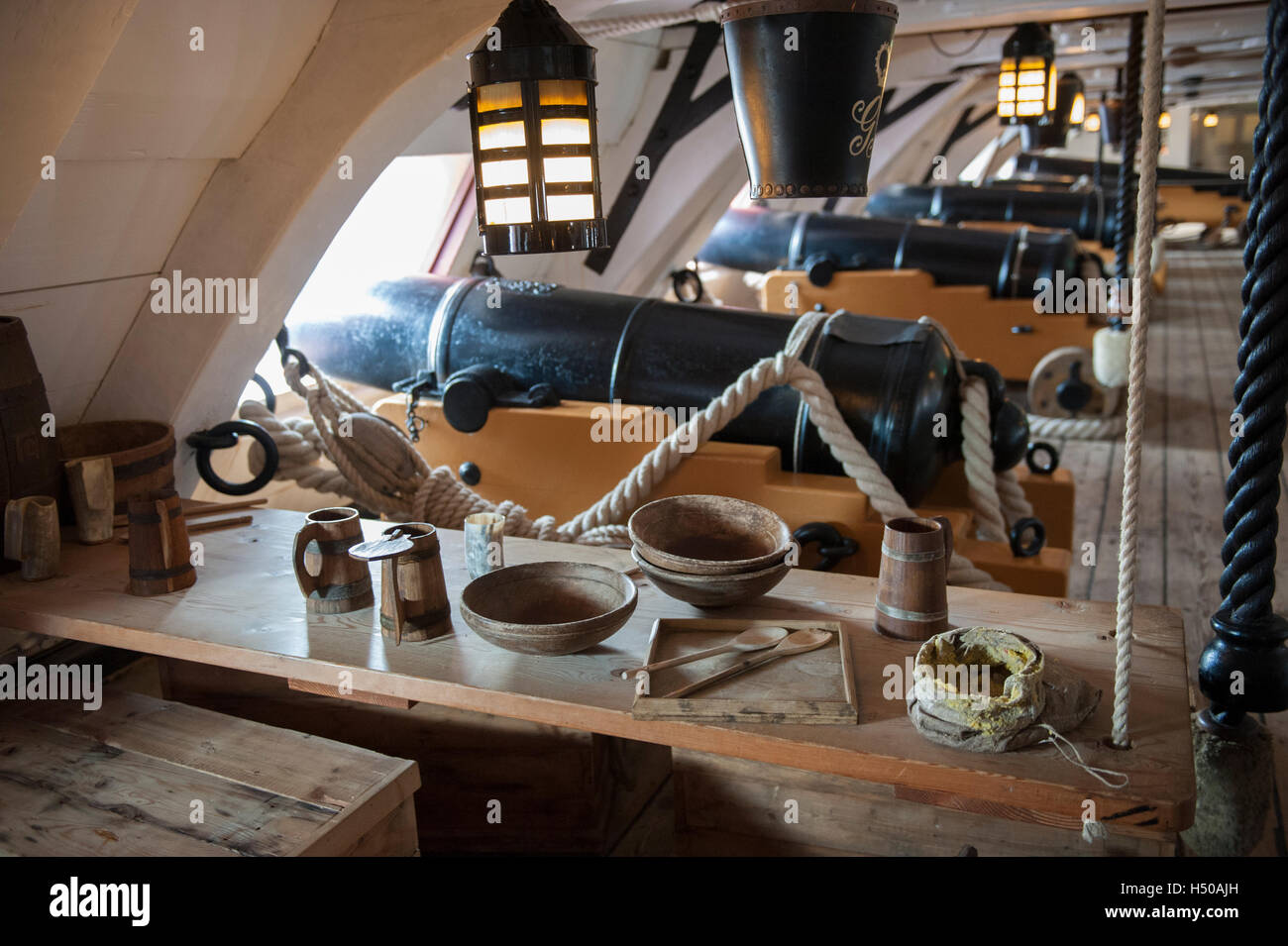 Mess table on gun deck of HMS Victory, Portsmouth Historic Dockyard, England - Stock Image