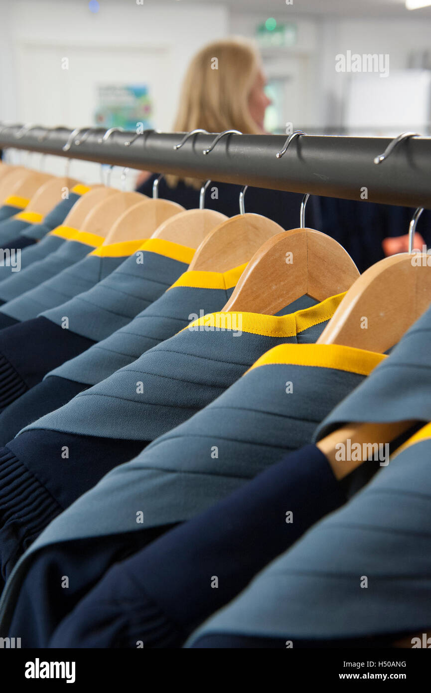 Academic gowns hanging on a clothes rail - Stock Image