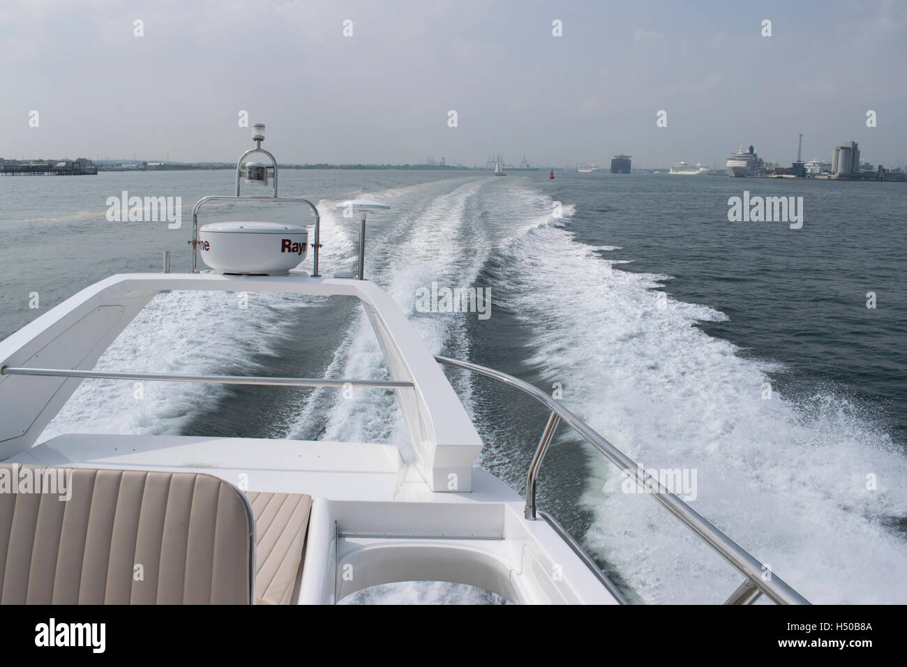 Powerboat leaving Southampton Port at speed - Stock Image