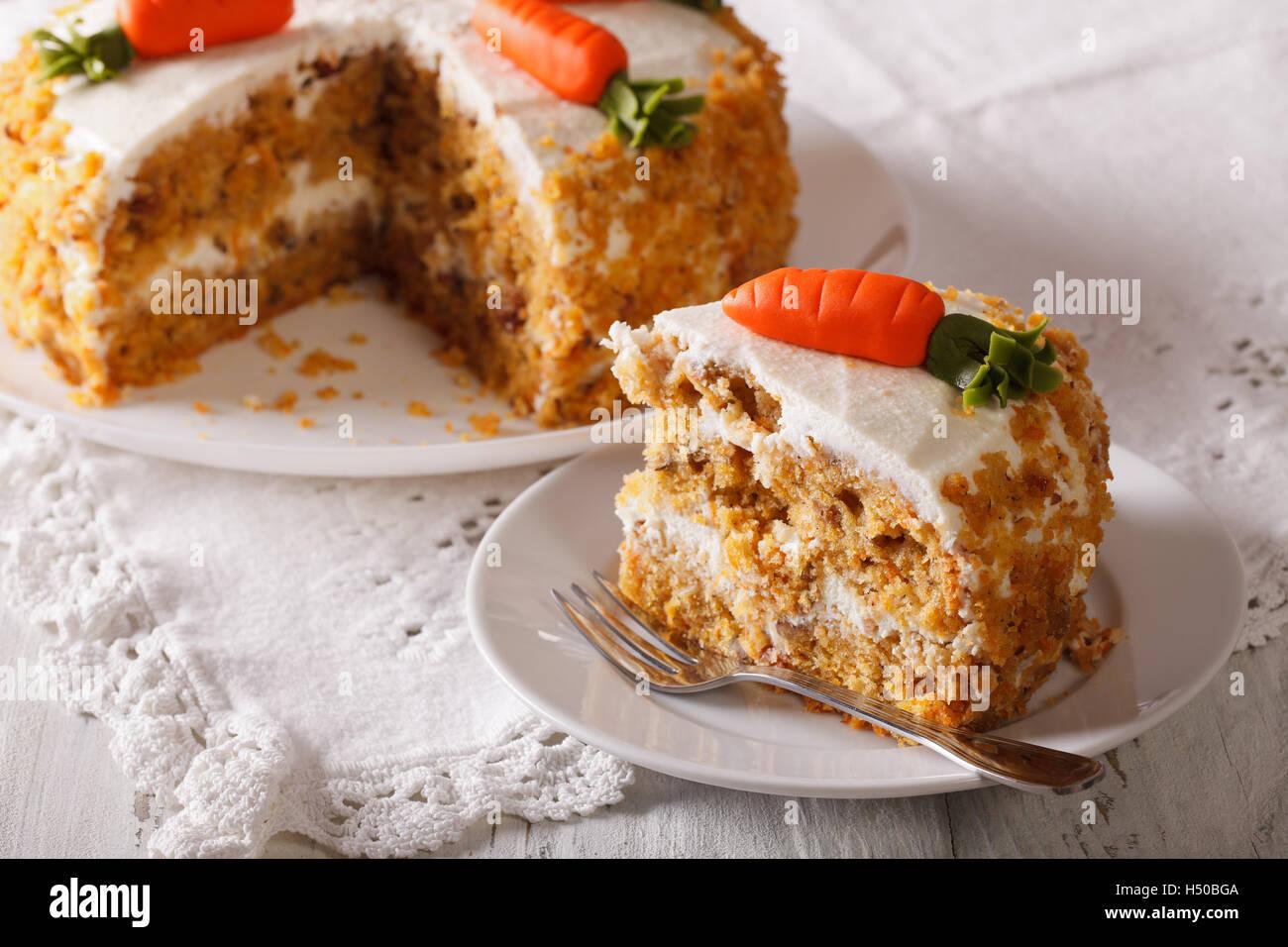 Homemade desserts: sliced carrot cake on a plate closeup. horizontal - Stock Image
