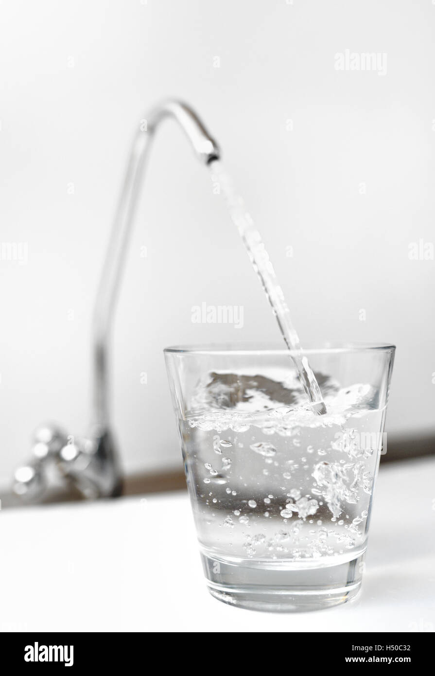 A glass of water from filter tap - Stock Image