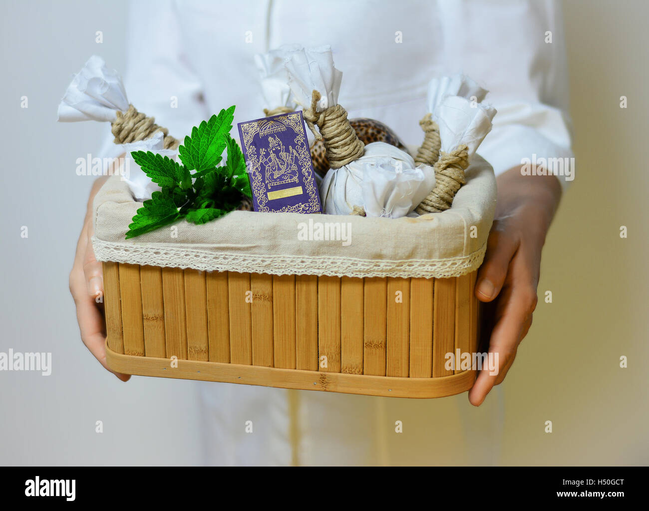 Beautician holding equipment for massage and aroma therapy. - Stock Image