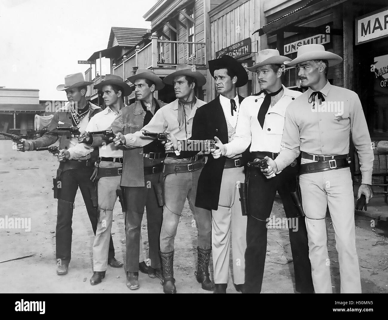 WARNER BROS TV WESTERN STARS 1959. From left: Will Hutchins (Sugarfoot) , Peter Brown (Lawman), Jack Kelly (Maverick), - Stock Image