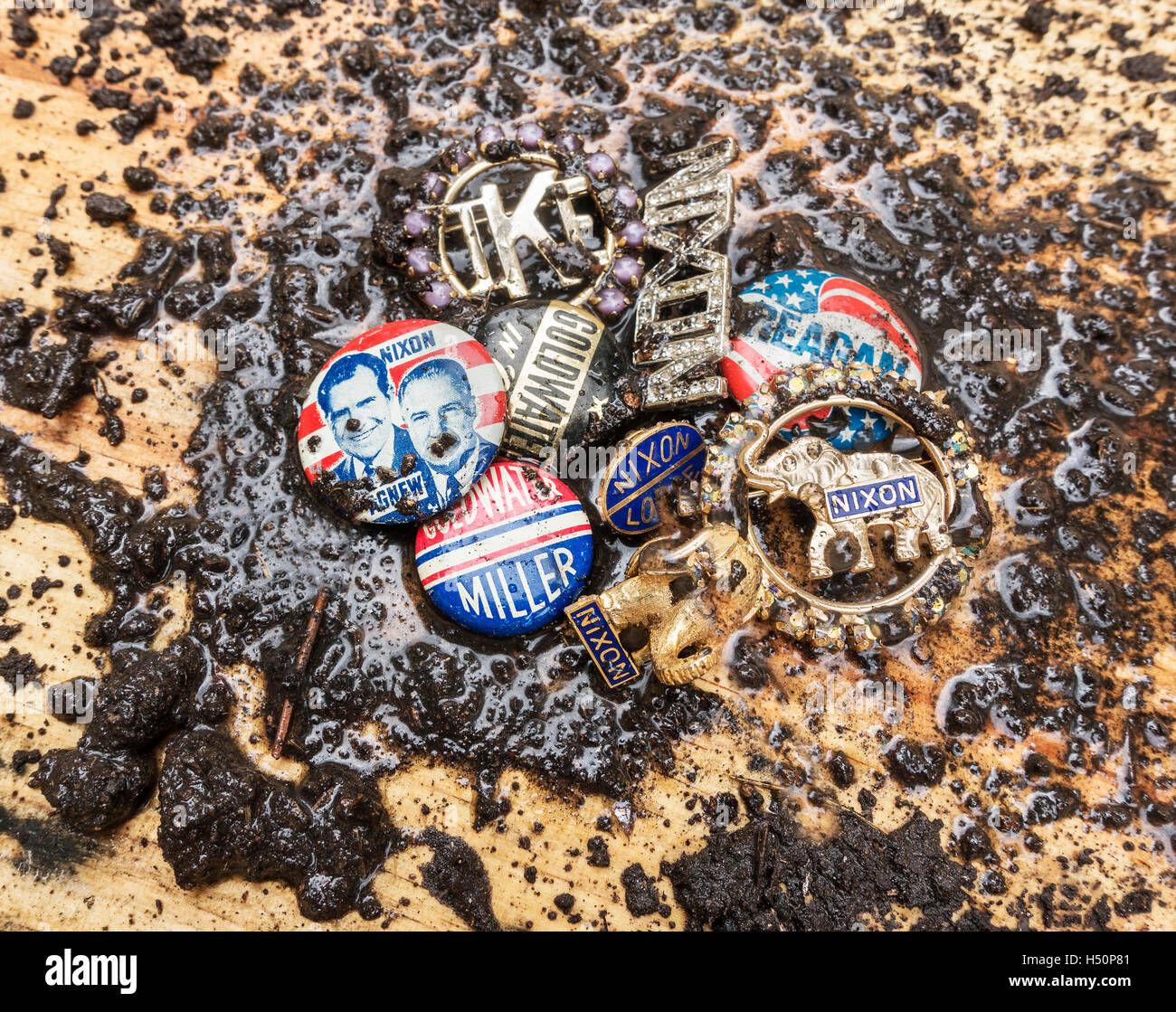 Caption:  Catskill, NY/USA -CIRCA October 2016 - mud splattered Republican Party campaign pins  Description: mud - Stock Image