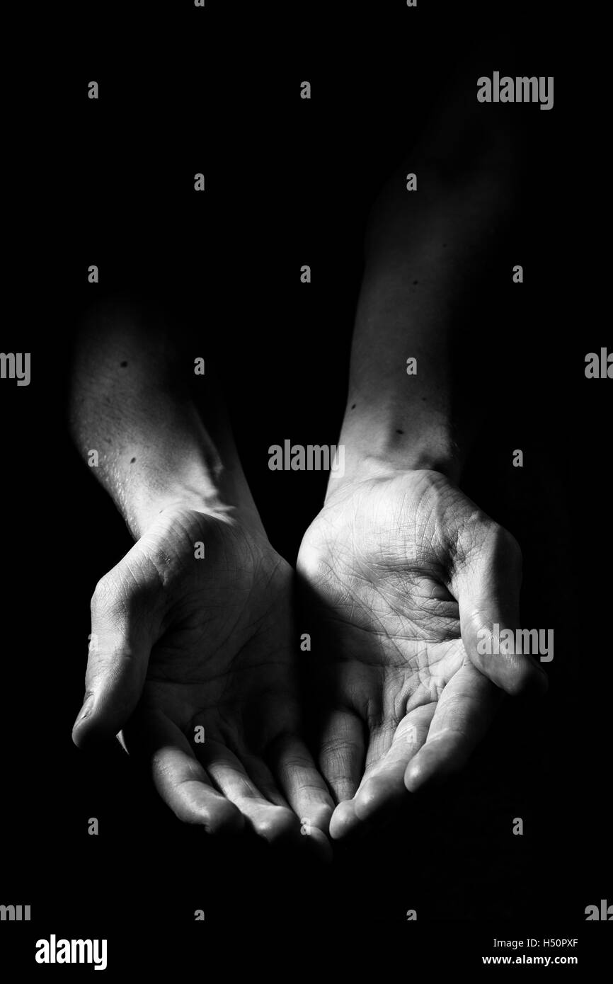 Hands in the darkness - Stock Image