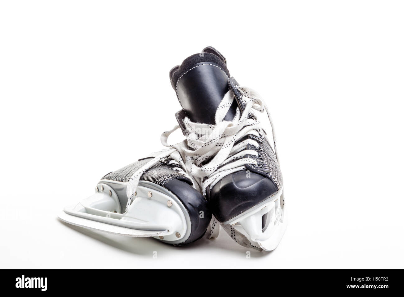 A pair of ice hockey skates isolated on white background with copy space. - Stock Image