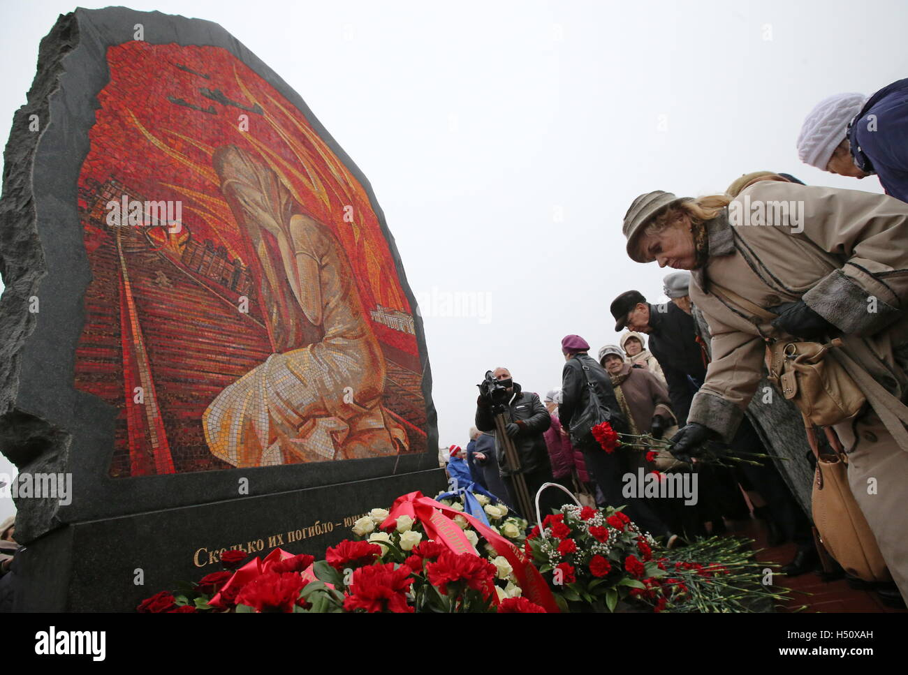 TIKHVIN, LENINGRAD REGION, RUSSIA - OCTOBER 14, 2016: Residents lay flowers at a war memorial unveiled to mark the - Stock Image
