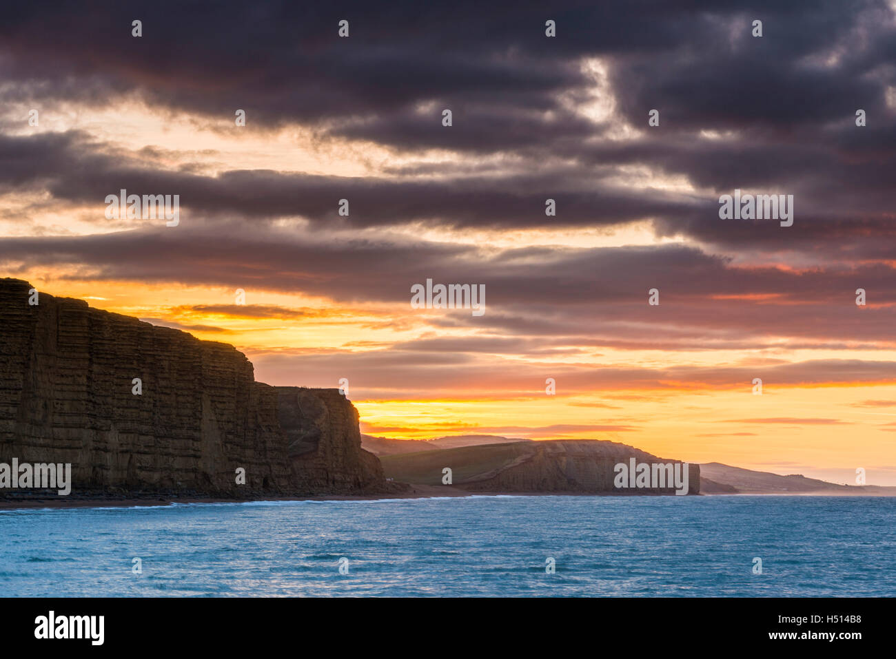West Bay, Dorset, UK.  19th October 2016.  UK Weather.  Spectacular sunrise at West Bay on the Jurassic Coast of - Stock Image