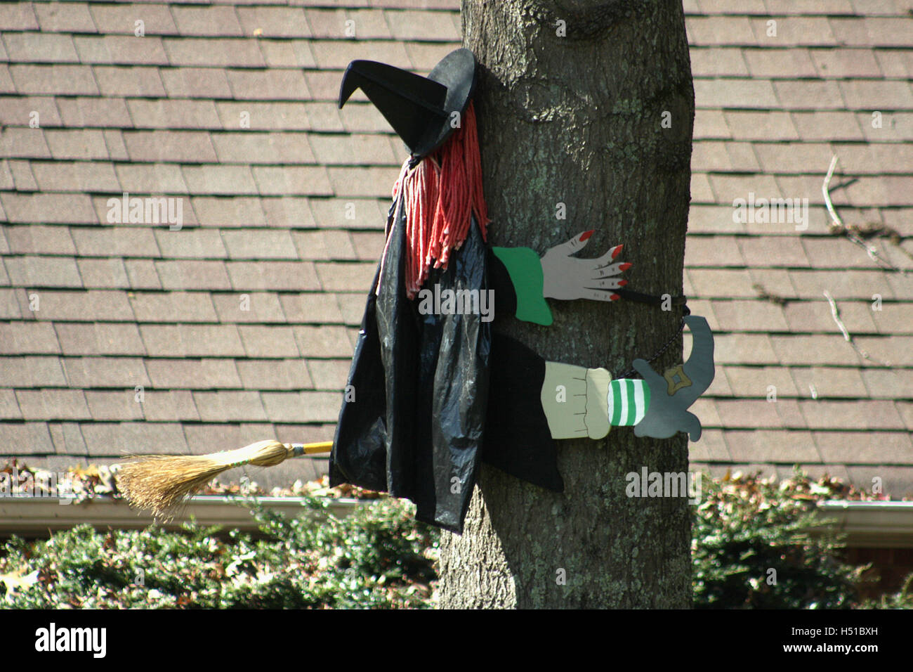 ical outdoor Halloween decoration of witch crushing into