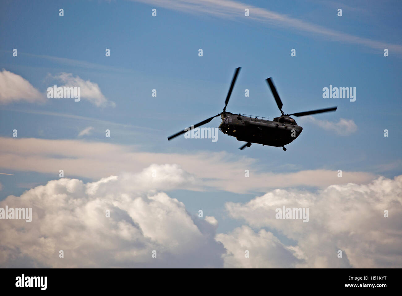 A Chinook HC4 operated by 28 Squadron RAF Benson, Oxfordshire, UK flies over farmland in West Hanney, Oxfordshire, - Stock Image