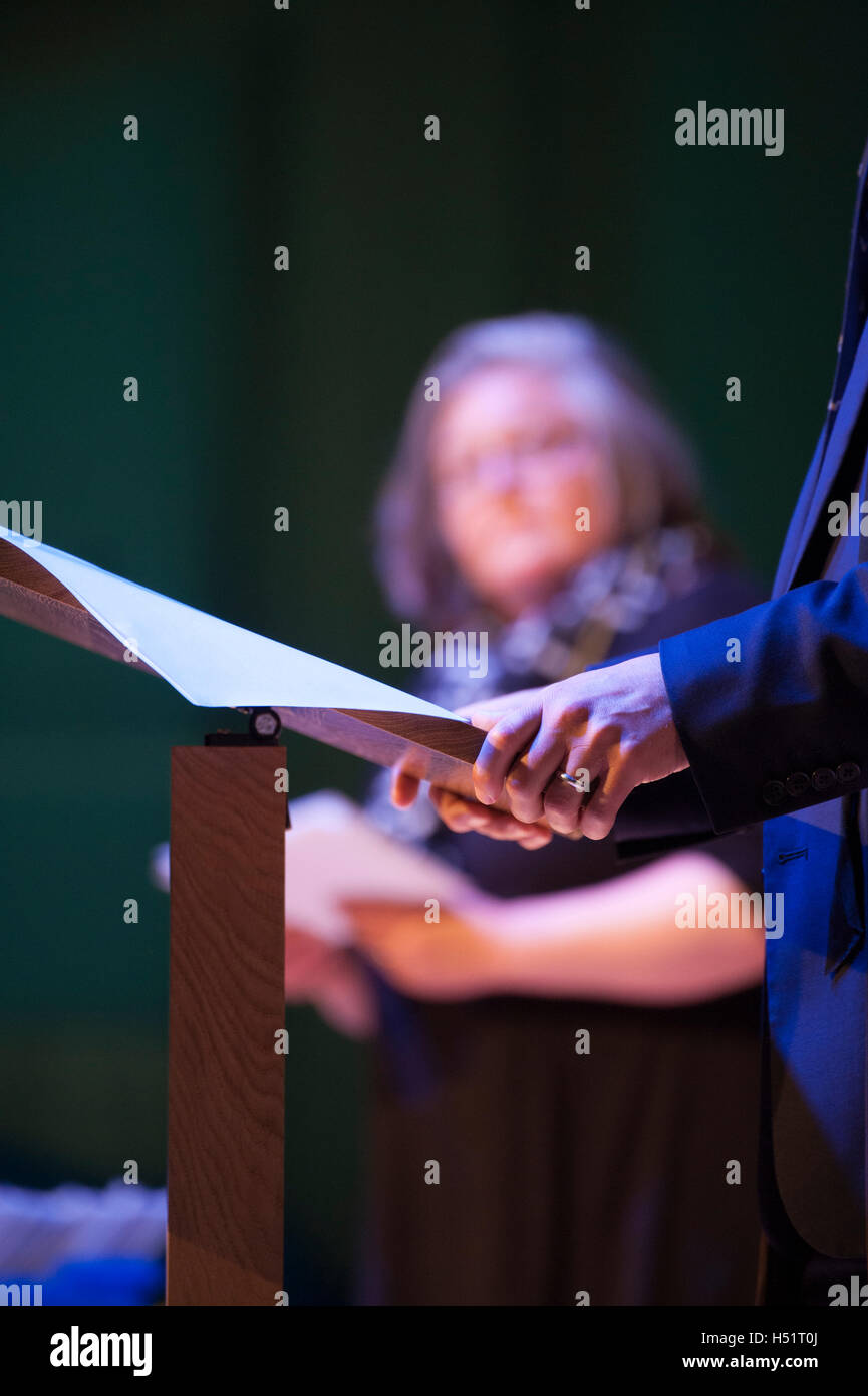 Hands on a lectern - Stock Image