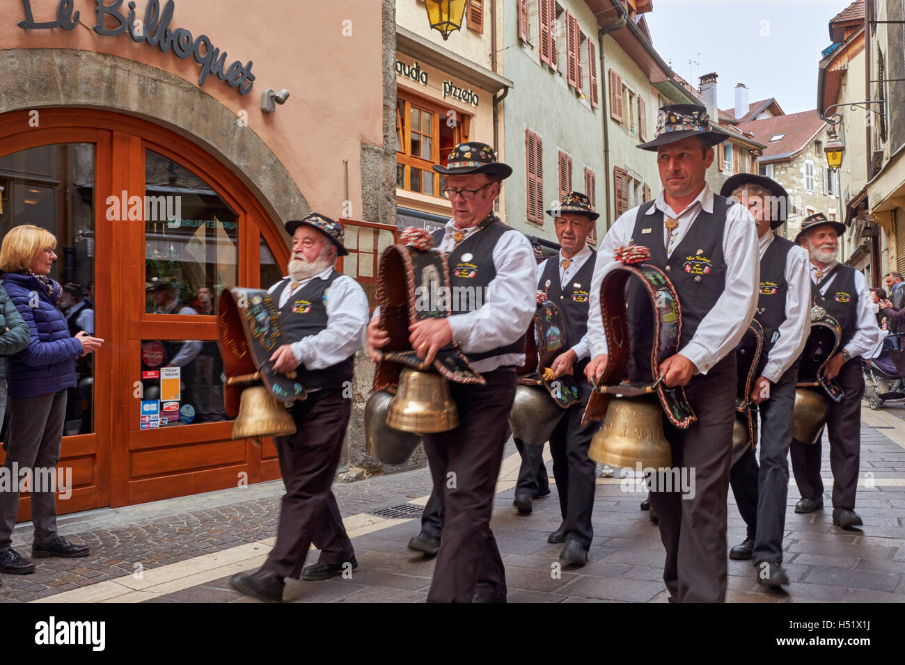 Group of men ringing cow bells during the Retour des Alpages festival. Annecy, Haute-Savoie, France. - Stock Image
