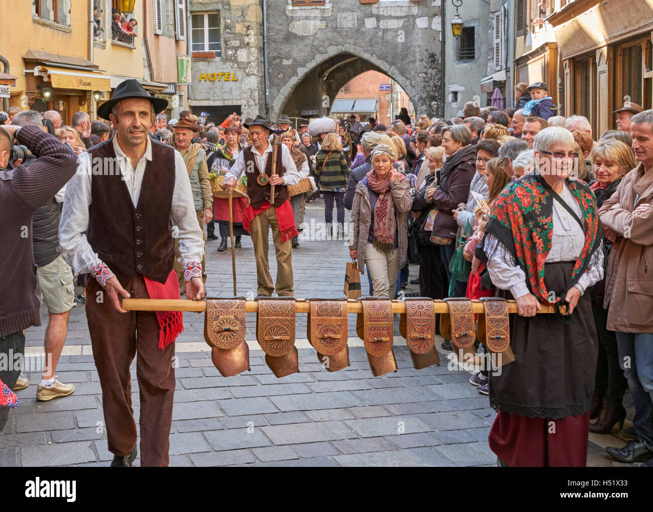 Ringing sheep bells during the Retour des Alpages festival. Annecy, Haute-Savoie, France. - Stock Image