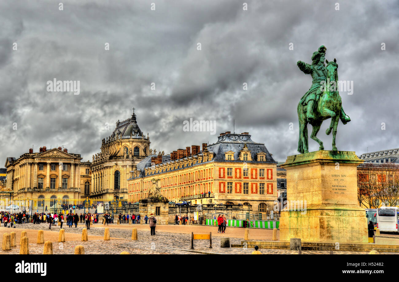 Statue of Louis XIV in front of the Palace of Versailles near Pa - Stock Image
