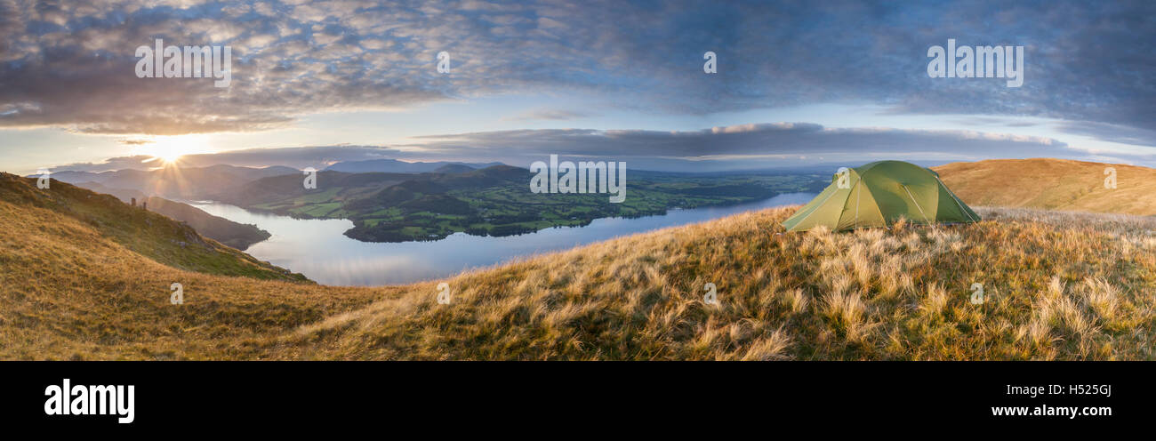 Wild camping tent on Bonscale Pike above Ullswater in the English Lake District on a late summer evening - Stock Image