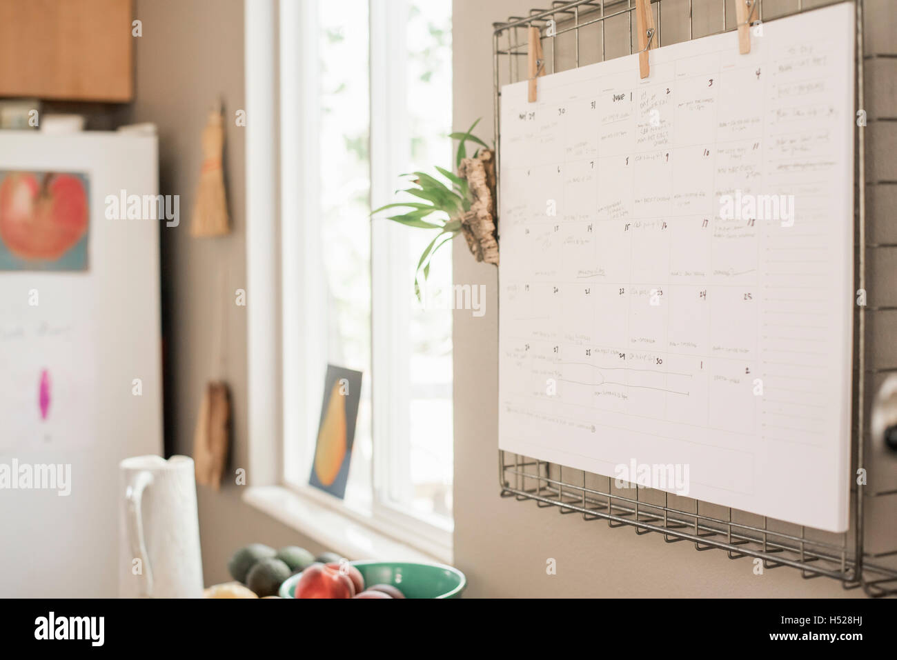 Wall planner on a kitchen wall. - Stock Image