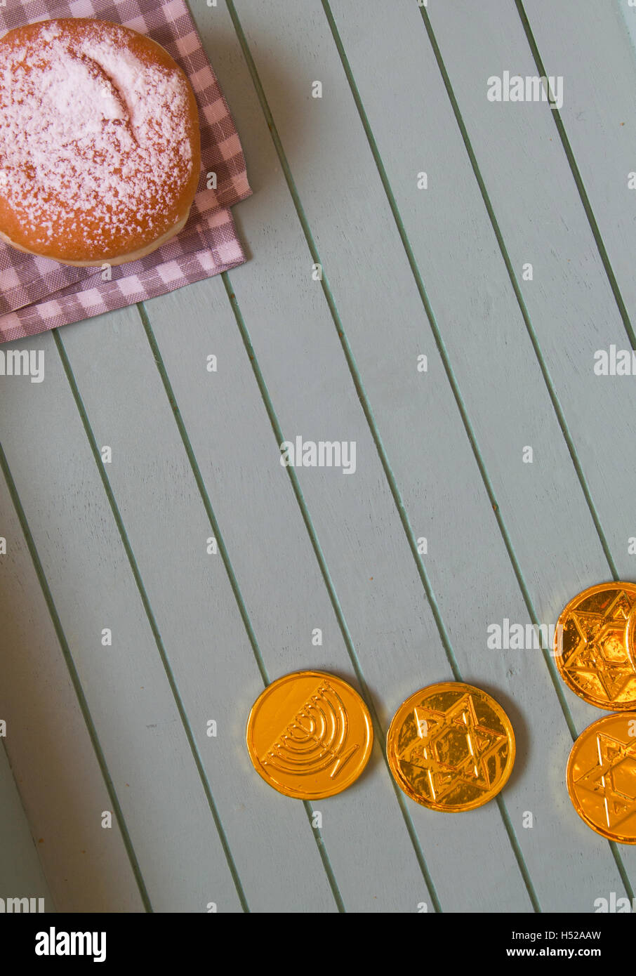 Flat Lay Jewish holiday hannukah symbols - donut and chockolate coins on vintage background,lot of copy space - Stock Image