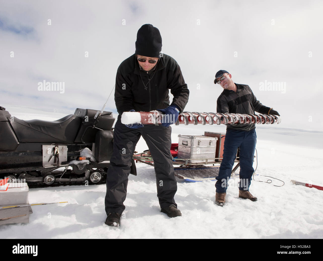Scientists with ice core samples doing glacial research on Vatnajokul Ice Cap, Iceland - Stock Image