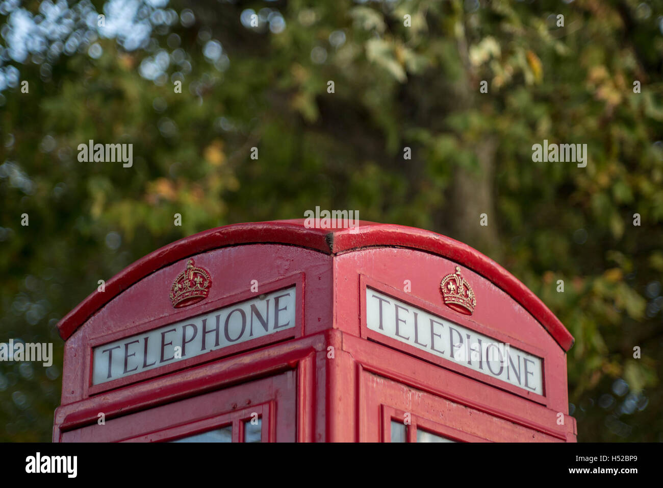 Common red British telephone box in London, UK. - Stock Image