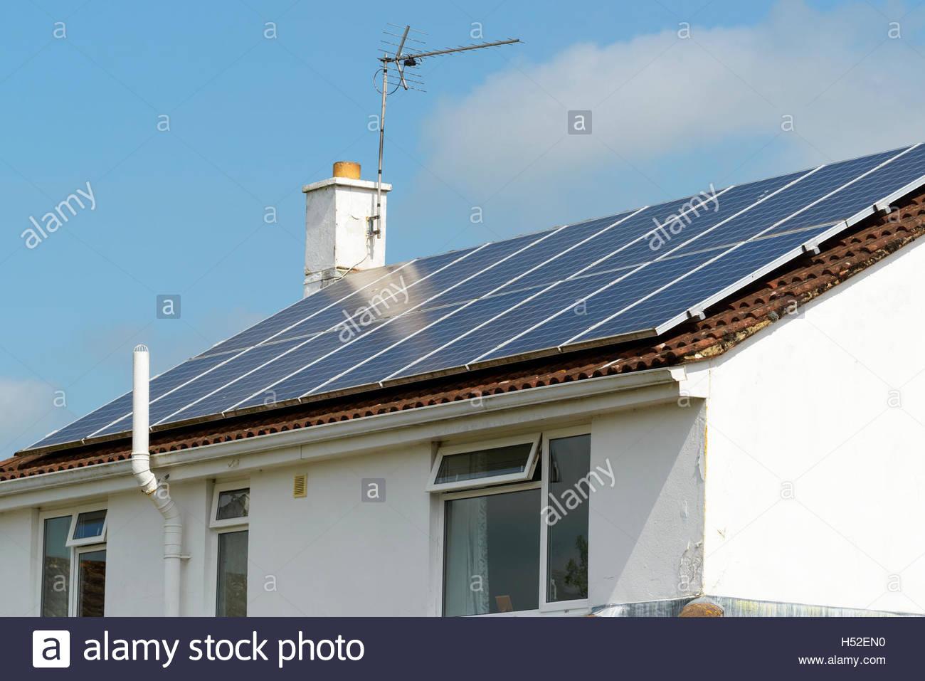 Solar panels on house roof, Blandford Forum, Dorset, England, UK - Stock Image