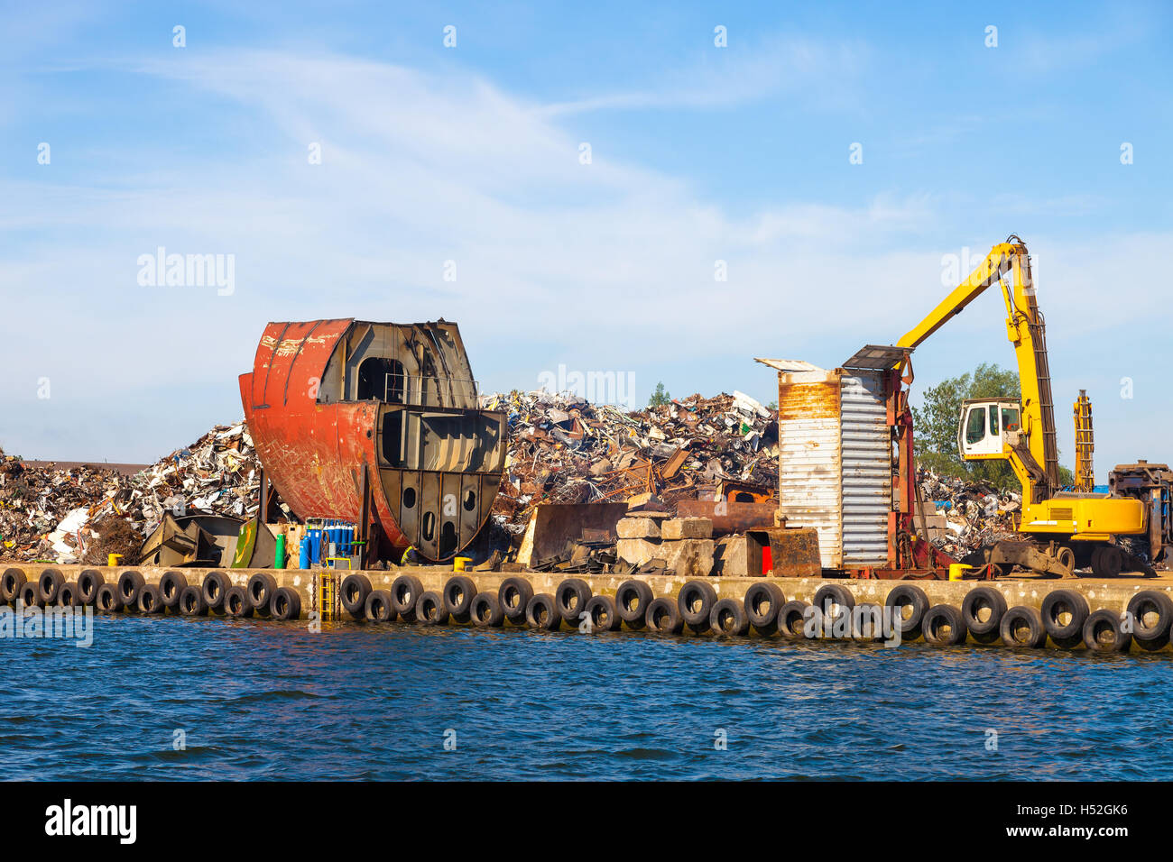 Dismantling the ship on scrap metal ready for recycling. - Stock Image