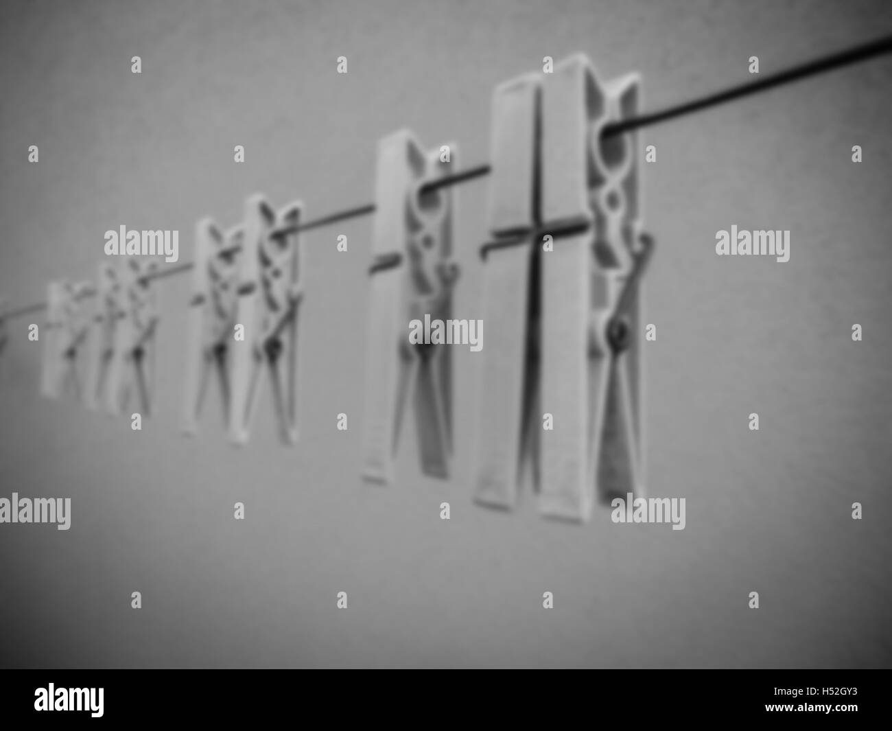Plastic clothespins as blurred background - vintage blurred effect - Stock Image
