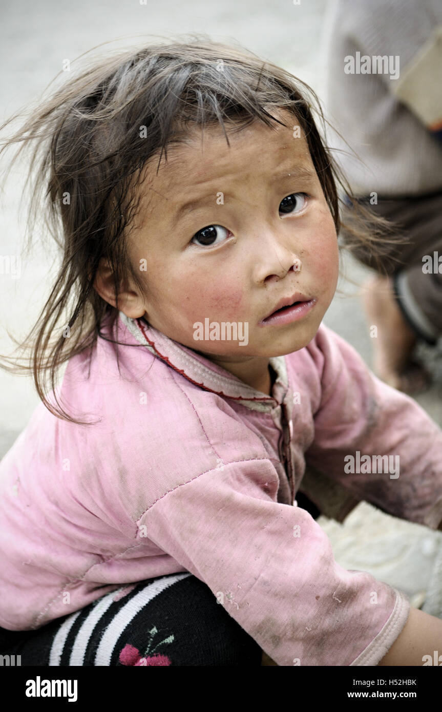 Little girl in a Hmong village in Ha Giang Province, North Vietnam Stock Photo