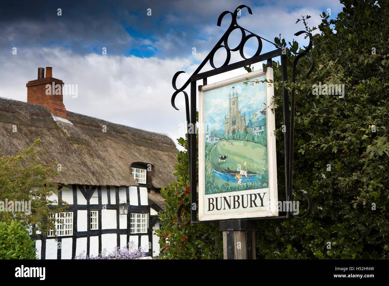 UK, England, Cheshire, Bunbury, Vicarage Lane, painted village sign - Stock Image