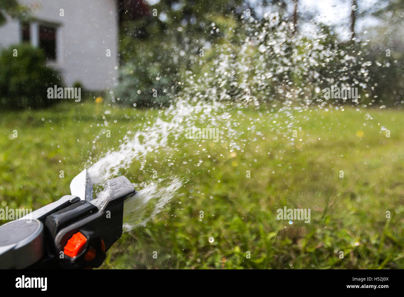 Water drops from sprinkler - Stock Image