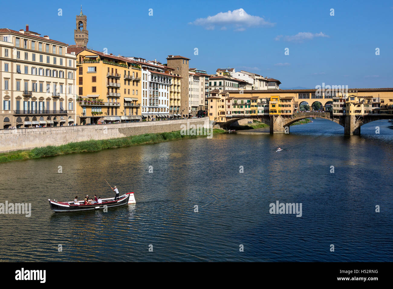 Florence, Italy - The Ponte Vecchio (Old Bridge] is a Medieval stone bridge over the Arno River. - Stock Image