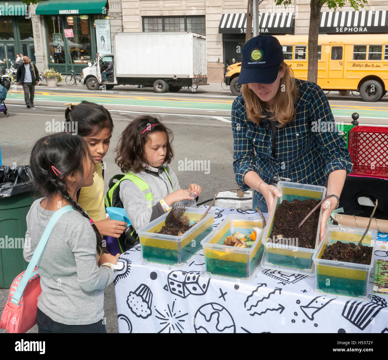 A worker from GrowNYC explains the intricacies of composting at the Geek Street Fair in Union Square Park in New - Stock Image