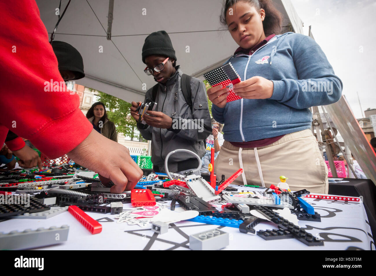 Participants experiment with Lego robotics in the Geek Street Fair in Union Square Park in New York on Thursday, - Stock Image