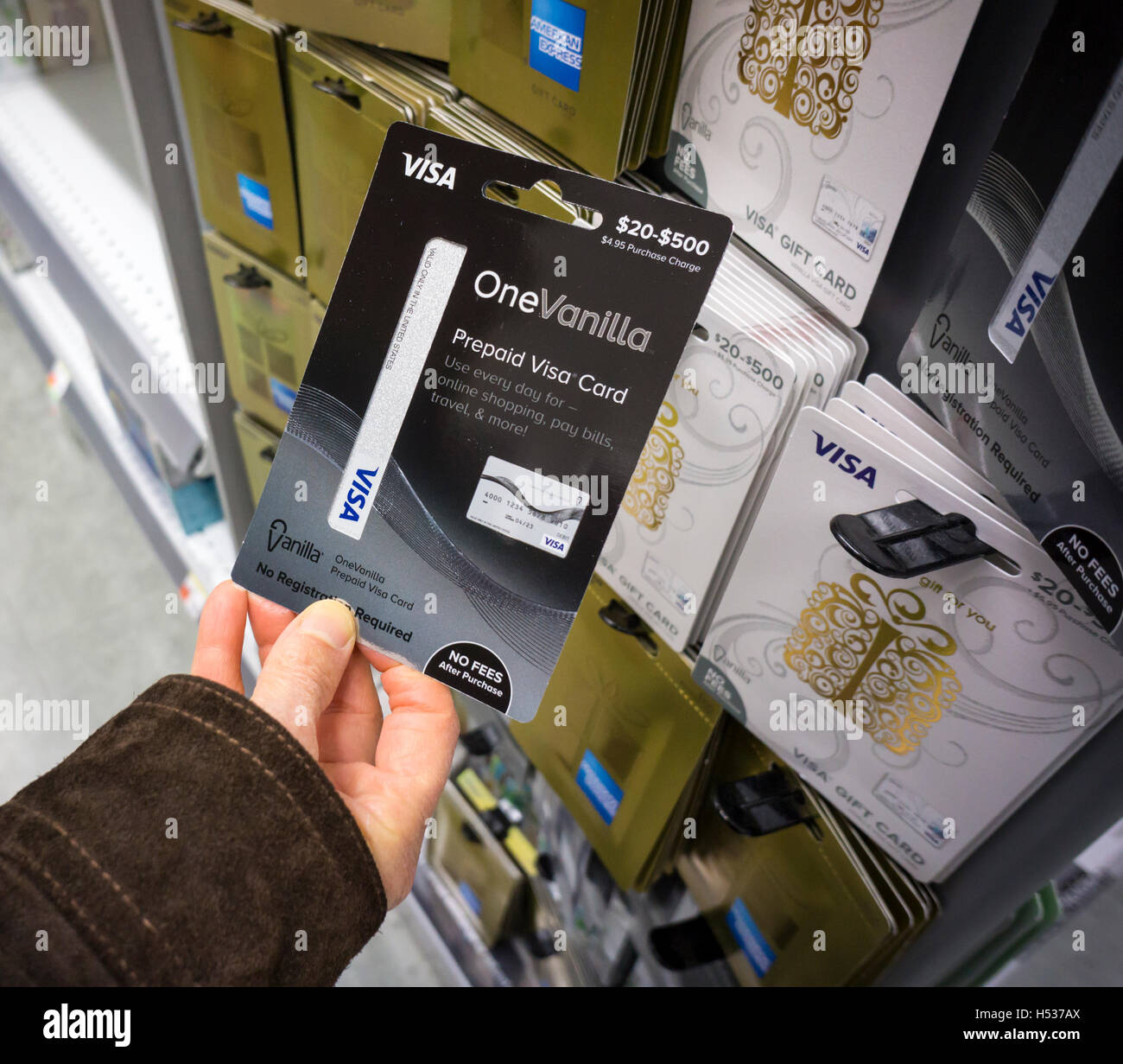a shopper chooses a vanilla brand visa debit card in a store in new york on - Prepaid Visa Cards Near Me