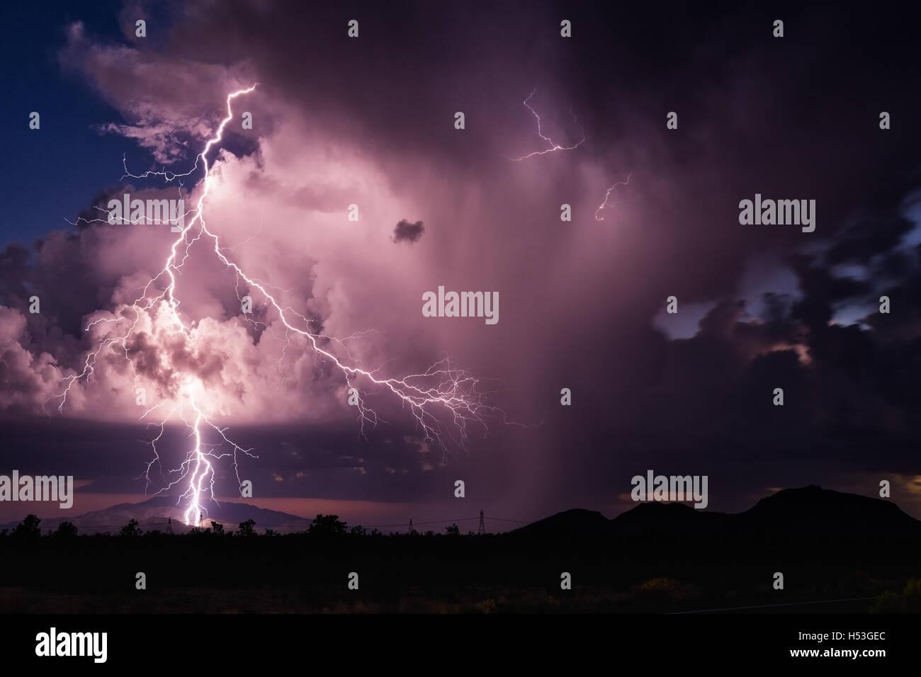 Lightning striking a mountain range in central Arizona Stock Photo