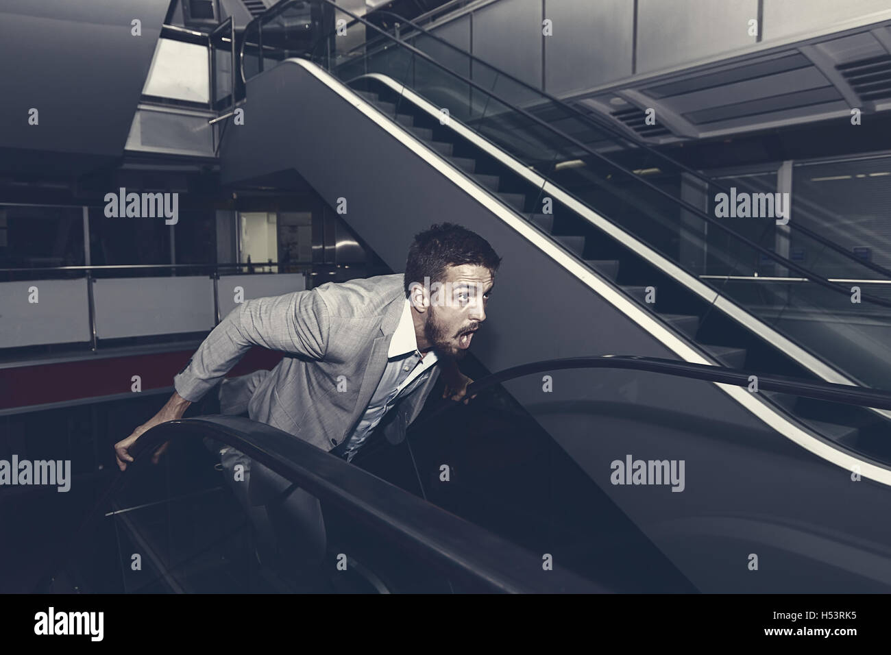 Frightened man run away. Stressed businessman. Scared man. - Stock Image