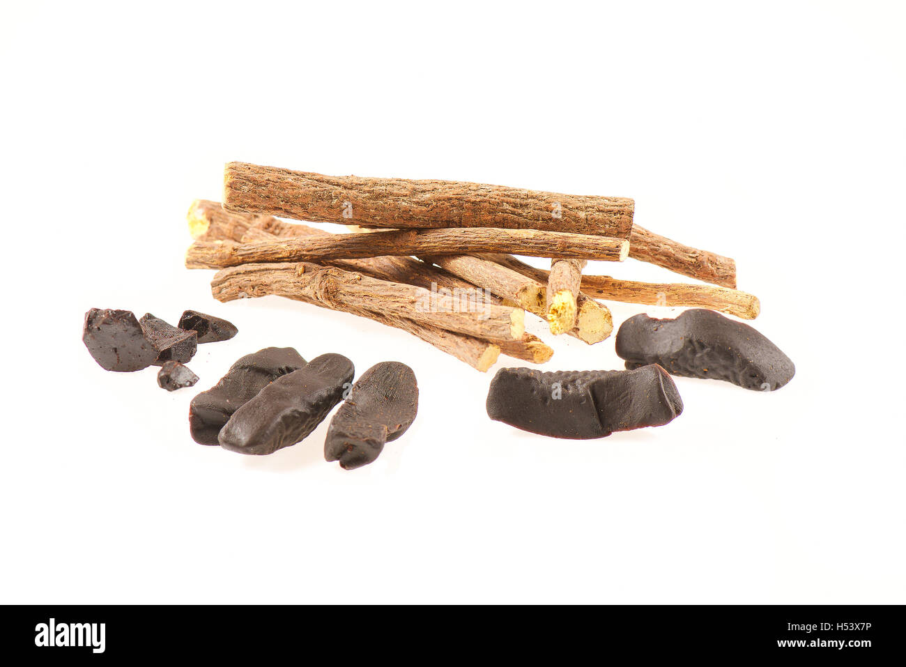 Liquorice sticks and candy on white background - Stock Image
