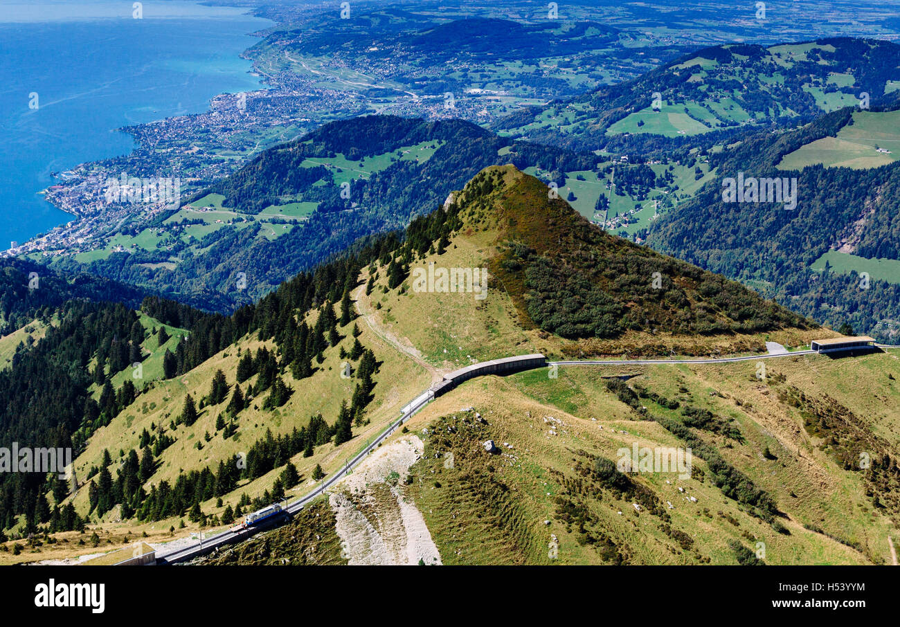 Viewpoint from mountain of Rochers-de-Naye overlooking Lake Geneva, the city of Montreux and its railway track, - Stock Image