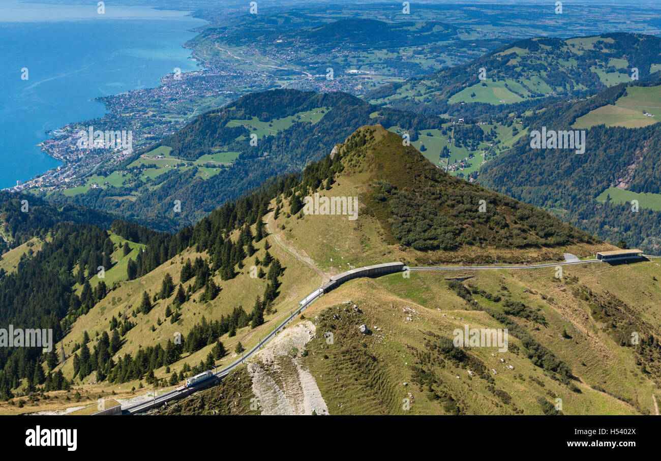 Viewpoint from mountain of Rochers-de-Naye overlooking Lake Geneva, the city of Montreux and the mountain railway - Stock Image
