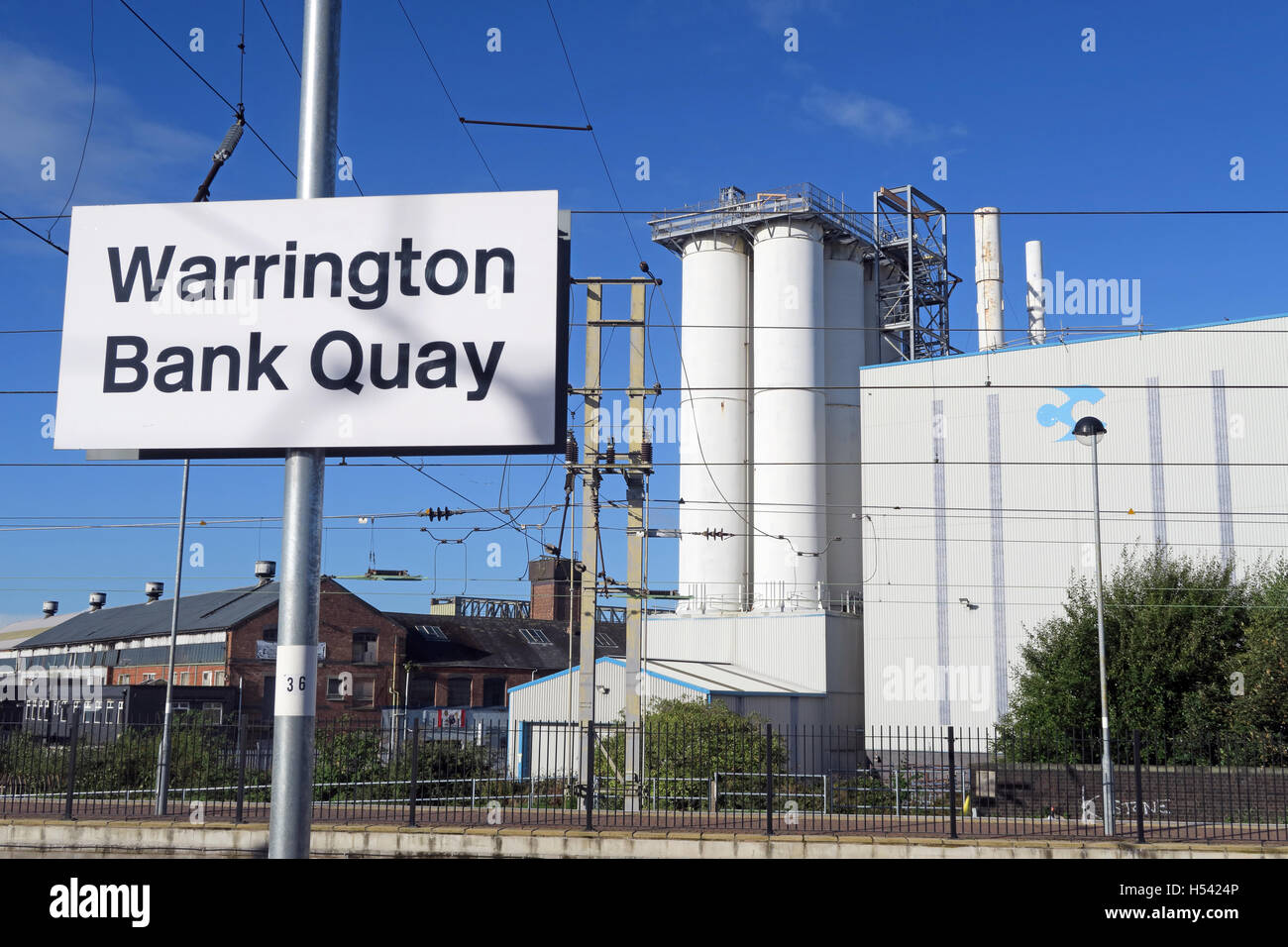 Warrington Bank Quay Rail Station, WCML Cheshire, England,UK -sign & Crossfields factory - Stock Image