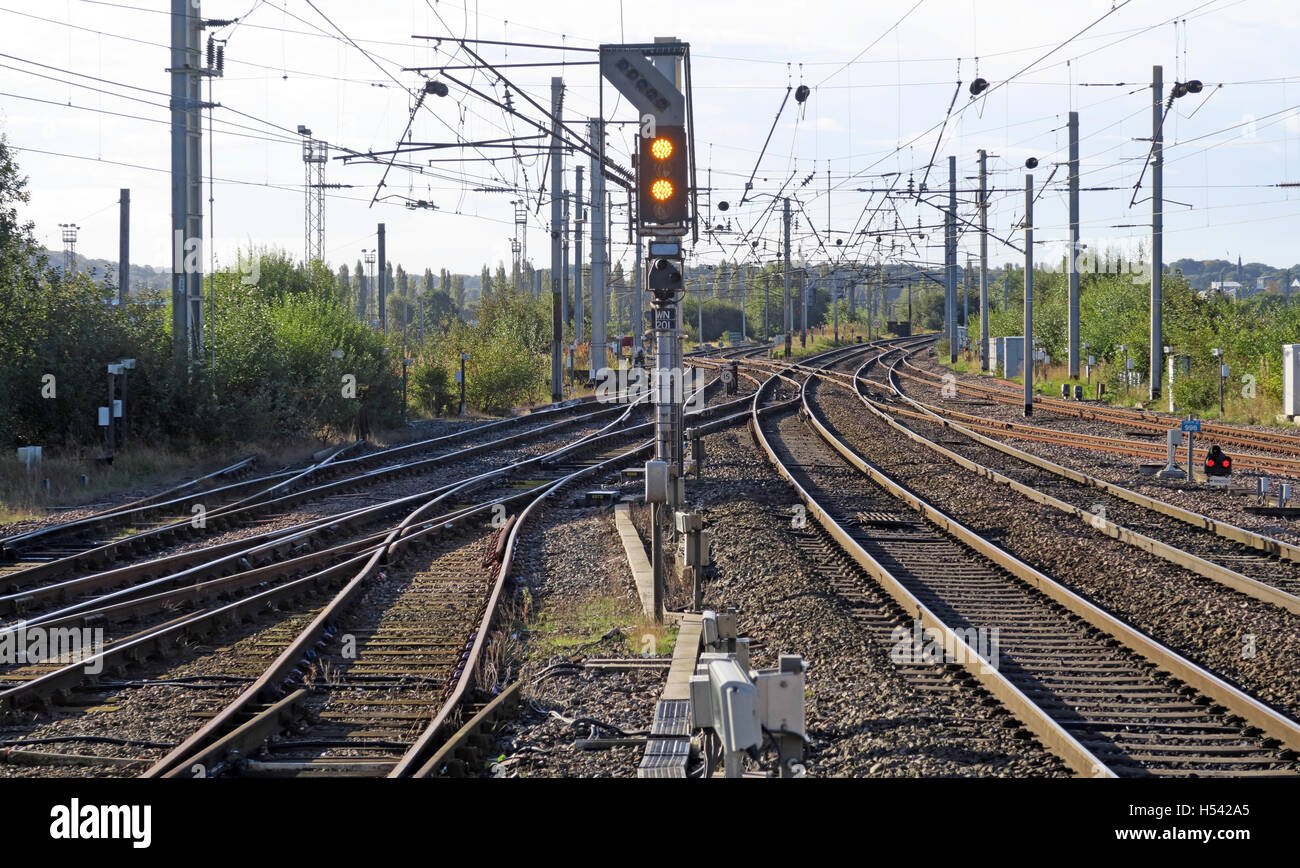 Overhead lines, electric train line,WCML with signal,England,UK - Stock Image