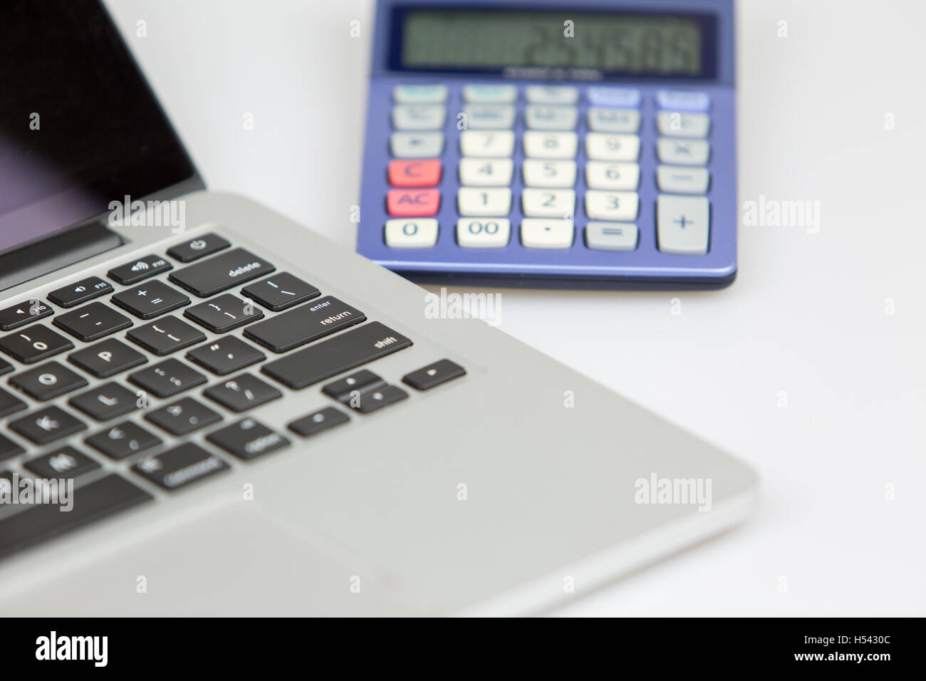 Calculator Watch Stock Photos Images Alamy Circuitry Of An Electronic Royalty Free Photography Laptop And On A White Background Digits Appearing Turned Off