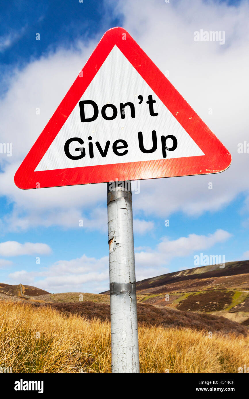 Don't give up persevere carry on continue sign motivational sign signs concept concepts conceptual UK England - Stock Image